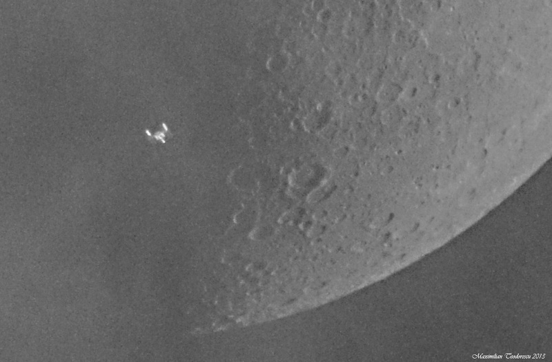 shot of the International Space Station passing across the Moon